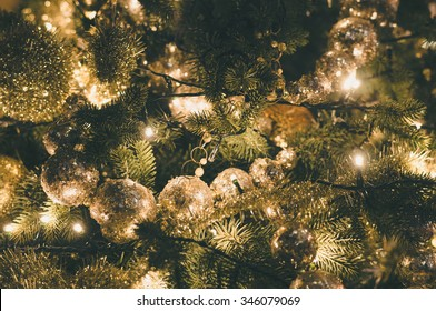 Decorated and illuminated christmas tree, vintage toning