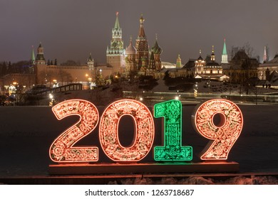Decorated and illuminated number 2019 year and Moscow Kremlin on the background
