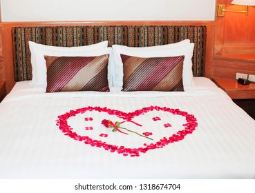 Decorated with love and roses on the bed in the hotel. Wedding decoration