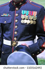 Decorated Marine in dress blues displaying medals
