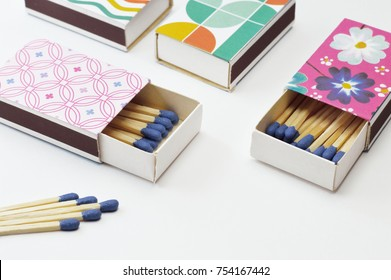 Decorated matchboxes on white background, ideal for your crafts projects or tools topics in your publications.