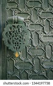 Decorated metal door and handel