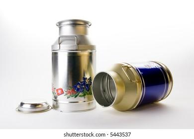 Decorated milk tin plate kettles on white bottom