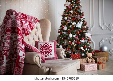 Decorated for the new year interior of the house-the General plan. Christmas tree and decorated Studio, lights garlands, decorations, gift boxes in a cozy home.