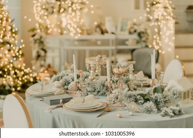 decorated New Year's table in light turquoise colors