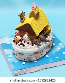 Decorated novelty cake: Noah's ark with animal couples on board