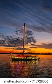 A Decorated Sailboat Cruises Past a Florida Sunset/Boat Parade