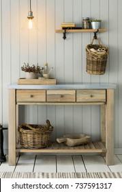 Decorated sideboard in room. Wood cupboard