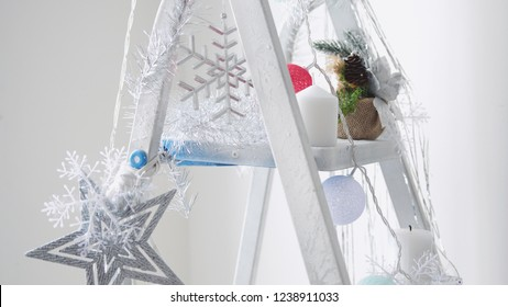 Decorated stepladder in the new year style. Christmas concept
