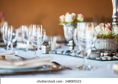 Decorated table with glassware and cutlery at a wedding reception