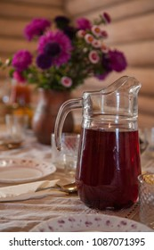 Decorated table with jug of juice on foreground