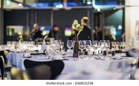 Decorated table on a gala dinner party with wine glasses and blurred out background