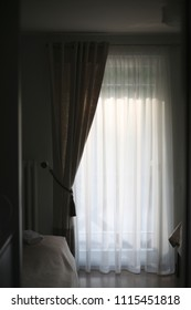 Decorated with tulle and curtains the window in the bedroom