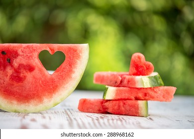 decorated watermelon slices with heart shape