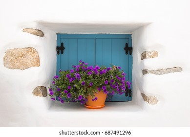 Decorated window with beautiful flowers at Chora - Ano Koufonissi island