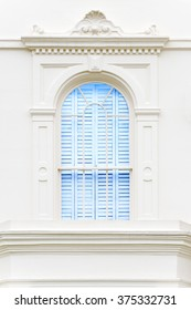 Decorated Window in London House, UK. Blue window in front of Victorian white building.