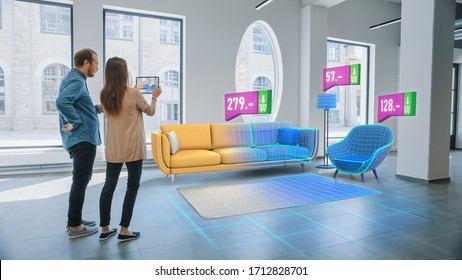 Decorating Apartment: Lovely Young Couple Use Digital Tablet with Augmented Reality Interior Design Software to Choose 3D Furniture for their Home. Furniture from Online Shop with Prices.