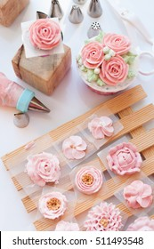 decorating cake, piping flowers buttercream