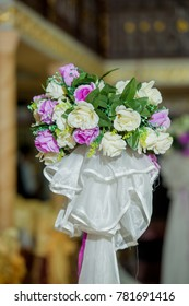 Decorating a holiday with artificial flowers