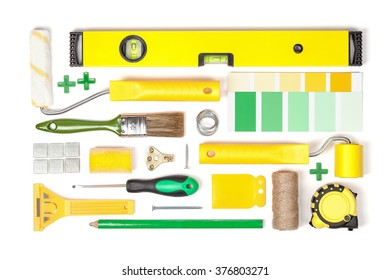 decorating and house renovation tools and accessories on white background top view. flat lay composition in yellow and green colors