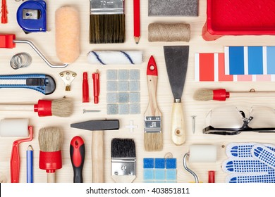 decorating and house renovation tools and accessories on wooden background top view. painter and decorator work table