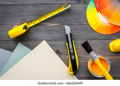 decorating and house renovation tools and accessories on wooden table background top view mockup