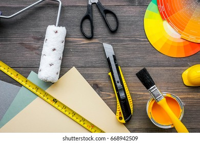 decorating and house renovation tools and accessories on wooden table background top view