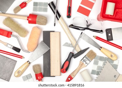 decorating and house renovation tools on white background. painter and decorator working table. creative mess composition top view