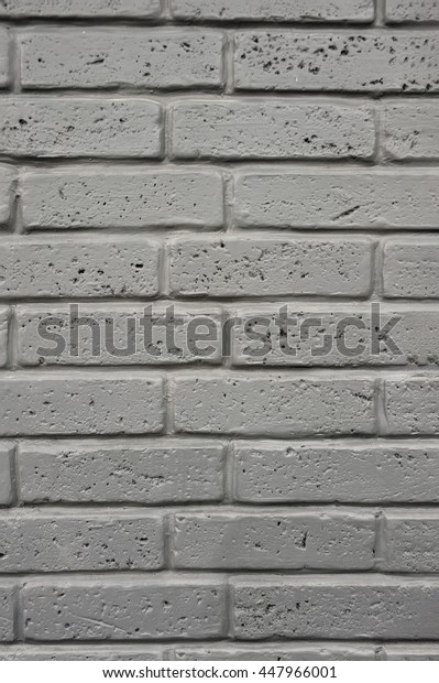 Decorating the walls of a beautiful decorative bricks , plaster , pattern , texture , the background