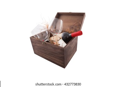 Decorating wooden box with wine bottle, wine glasses, sweet present for every kind of celebration isolated on white background