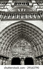 Decoration above the door of Notre Dame cathedral in Paris, France. Black and white.