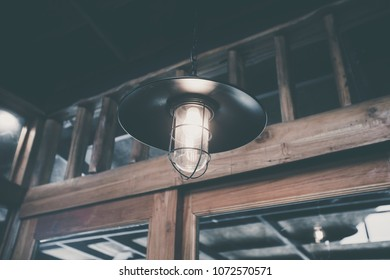 Decoration antique edison led light style filament light bulbs ,turn on the light , color vintage style , focus only led light blur wooden background country style ,Thailand