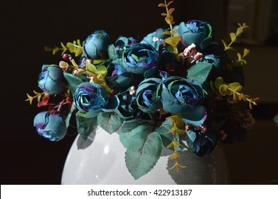 Decoration artificial blue and green flowers