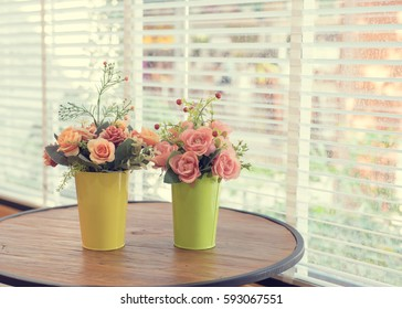 Decoration artificial flower in the pot on table - vintage effect style.