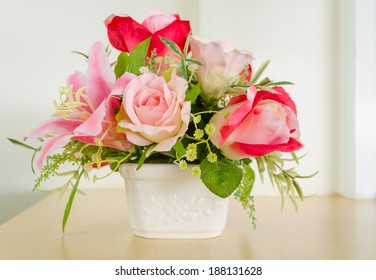 Decoration artificial flower-beautiful pink rose  in white pot.
