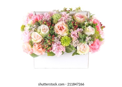 Decoration artificial plastic flower with vintage design basket isolated on white background