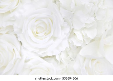 Decoration artificial white roses flower bouquet as a floral background with soft focus and copy space.