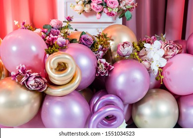 Decoration balloons and flowers on pink background