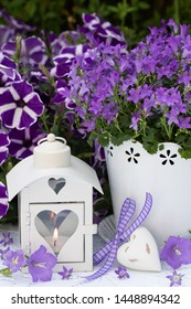 decoration with bellflower in purple and lantern with heart ornament