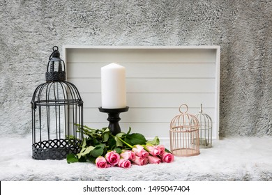 Decoration with bird cages, candle and white wooden tray