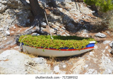 Decoration with a boat, besides a harbor in the Calanques, Marseille