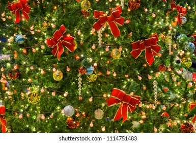 Decoration christmas tree with crystal ball and ribbon for background in New year festival every year.