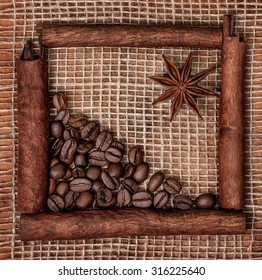 Decoration of cinnamon sticks, star anise and coffee beans on sacking