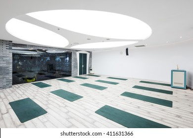 decoration and design of yoga room with big round light in modern gym