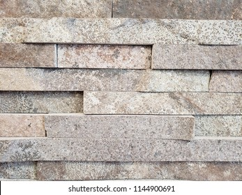 decoration for exterior walls with stone blocks in light gray color, background and texture