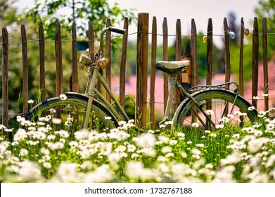 decoration at a fence with flowers in a bavarian garden in Germany