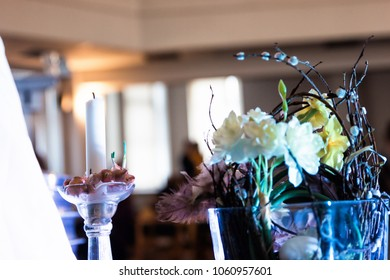 Decoration, flowers and candle with blurry background of people