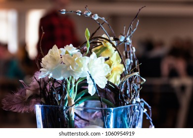 Decoration, flowers in glass vase with blurry background of people