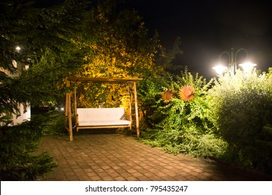 Decoration and furniture hammock with lighting in garden of resort in night time at Pfunds village in Tyrol, Austria