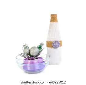 Decoration in a glass Cup. Ribbon, Christmas balls, Christmas tree. On a white background